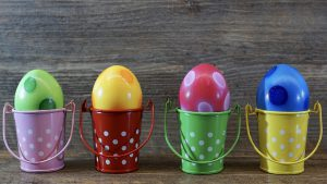 Colorful Eggs in Small Colorful Buckets